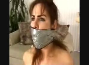 Chairtied Busty Brunette Gets MASSIVELY Gagged
