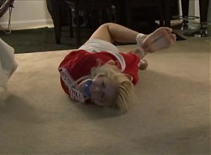 Cute coed struggles in tight hogtie