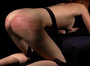 Slave endures hard spanking