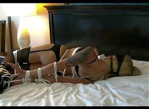 Ballet boot girl hogtied on bed