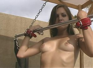 Stunning young brunette bdsm girl is stripped and restrained