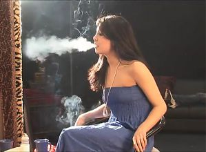 Smoking brunette in profile