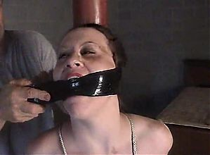 :Pole tied slave is severely gagged