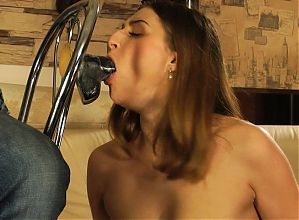 Pretty girl sucks dildo, and gets rubber band punishment.