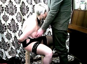 A young Master teaches obedience to a mature busty Lady